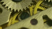 cep : Clockwork Gears Close Up (HD). Brass gears moving inside a clockwork from a pocket-watch seen in extreme closeup.