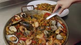rice dishes : Paella Spanish Cuisine Dish Uncovered and Served on a Dish