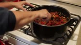 chef kitchen : Female chef cooking on kitchen stove. Camera dollies in. Stock Footage