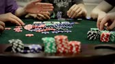 gamble : A group of adults (gentlemen) play texas holdem poker