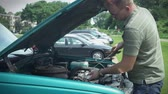 verificar : Checking oil under hood of car vehicle. Adding oil.