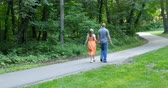 heterossexual : Young couple, in love, walking together on a late summer (early fall) day. 4K