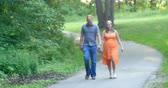 Young couple, in love, walking together on a late summer (early fall) day. 4K