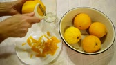 vitaminok : Removing the zest from the orange to make liquor.