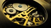 ネジ : Close up of an internal clock mechanism 動画素材