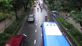 életmód : HO CHI MINH, VIETNAM - MAY 11 2017: Undefined motorcycle traffic in rain. Is located in the South of Vietnam, is the countrys largest city, population 8 million