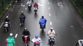 életmód : HO CHI MINH, VIETNAM - MARCH 11 2017: Motorcycle traffic in Ho Chi Minh city. Is located in the South of Vietnam, is the countrys largest city, population 8 million Stock mozgókép