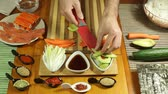 vegetable : Chopping fresh avocado for making Sushi roll Stock Footage
