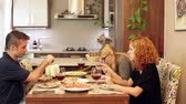 kitchen : Group of friends having lunch in dining room at home.