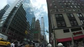 kereszt : New York City, USA - 13 May 2015: Traffic and skyscrapers around crossroad at West 57th Street and 8th Avenue in Midtown Manhattan.