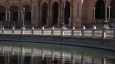 Seville, Spain - 21 September 2015: Detail of river, architecture and tourists at the Plaza de Espana located in the Maria Luisa Park.
