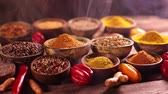 перчинка : Assortment of spices in wooden bowl background Стоковые видеозаписи