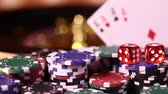 Poker Chips on gaming table, roulette wheel in motion