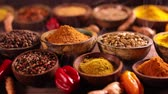 tatma : Colorful spices in bowl background Stok Video