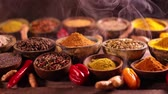 ingrediente : Assortment of spices in wooden bowl background Vídeos