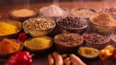 перчинка : Colorful spices in bowl background Стоковые видеозаписи