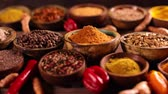 Aromatic spices on wooden background Stock Footage