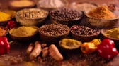 noz moscada : Assortment of spices in wooden bowl background Stock Footage