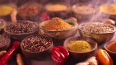 Spices and herbs selection on wooden background Stock Footage