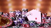 kugel : Poker Chips on gaming table, roulette wheel in motion