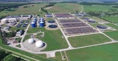 koku : Aerial view of storage tanks in sewage water treatment plant Stok Video
