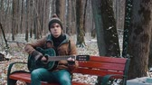 kytarista : people in the Park playing guitar in winter