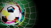 liga : Soccer ball soared into the net and the net was torn apart out. Archivo de Video