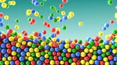 lolipop : Colorful chocolate candies coated shiny balls green background texture pattern Stok Video
