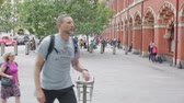 commute : LONDON, UK - JULY 26, 2016: Busy commuters entering and leaving St Pancras train station in london hand held Stock Footage