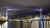 destino : Bizkaia Bridge at night, Biscay, Basque Country, Spain. Time lapse of the Hanging bridge, made in 1893, Unesco world heritage site.
