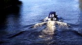 breaker : Little covered private motorboat dissecting the river surface with a lot of ripples Stock Footage