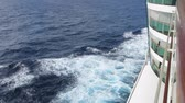 navigation : Waves breaking away from a cruise ship at sea Stock Footage