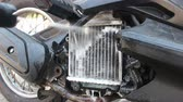 pressione : cleaning radiator of motorcycle