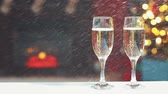 snow mantle : Room decorated for Christmas with two glasses of champagne with falling snow