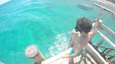 Sport jumping boy makes flip in sea turquoise water, SLOW MOTION 動画素材