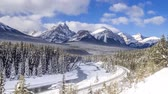 Time lapse of scenic Morants Curve in winter Banff National Park Alberta Canada in January. Clip has a train running down the tracks.