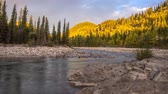 Time-lapse of sun rising along the Elbow River in Kananaskis Country, Alberta Canada.