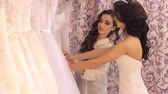 manto : Wedding Salon consultant helps the girl to choose the dress