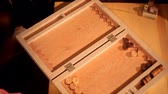 lookingdown : Two artistic girls play backgammon in a restaurant
