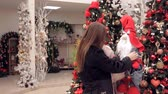 cláusula : two women playing with a Christmas gnome in the store