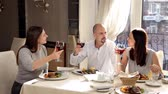 Friends have dinner in a restaurant and drink wine Stock Footage