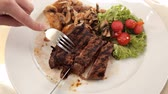 potato dishes : Grilled steaks and vegetables.Juicy Skirt steak in addition with a vegetable garnish. Dish from the chef