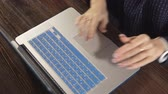 hırslı : a writer writes a book novel on a laptop against a brick wall Stok Video