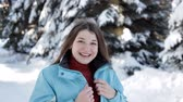 hógolyó : A young girl walks in the winter in the forest and poses for the camera