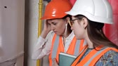 zawór : Two woman engineers checking technical data of heating system equipment in a boiler room