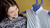 cottura a vapore : Young girl using steam system for Ironing clothes. Steamers blue blouse at home
