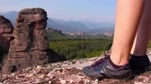 vale : Women feet in sport shoes step on a rock, tourist admire the Belogradchik valley
