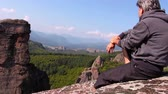 vale : Man sitting on a rock and admiring the beautiful Belogradchik valley