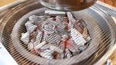 extractor : burning charcoal made of oak tree and thin wire grill in Korean beef restaurant