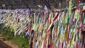 kerítés : Paju, Korea - May 8, 2014: ribbons of hope tied to wire fence in Imjingak Park. The park is located on the southern banks of the Imjin river and it has statues and mouments regarding the Korean War.